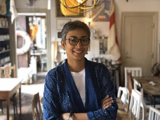 Photograph of Soumya James, the owner, founder, and artist at Kokuin.