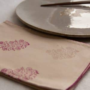 Napkin showing prints in the corner, and a dinner plate