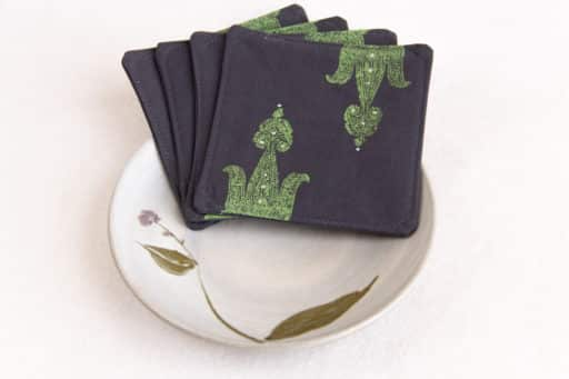 Sample Kokuin product image showing four woodblock printed fabric coasters inside a ceramic bowl.