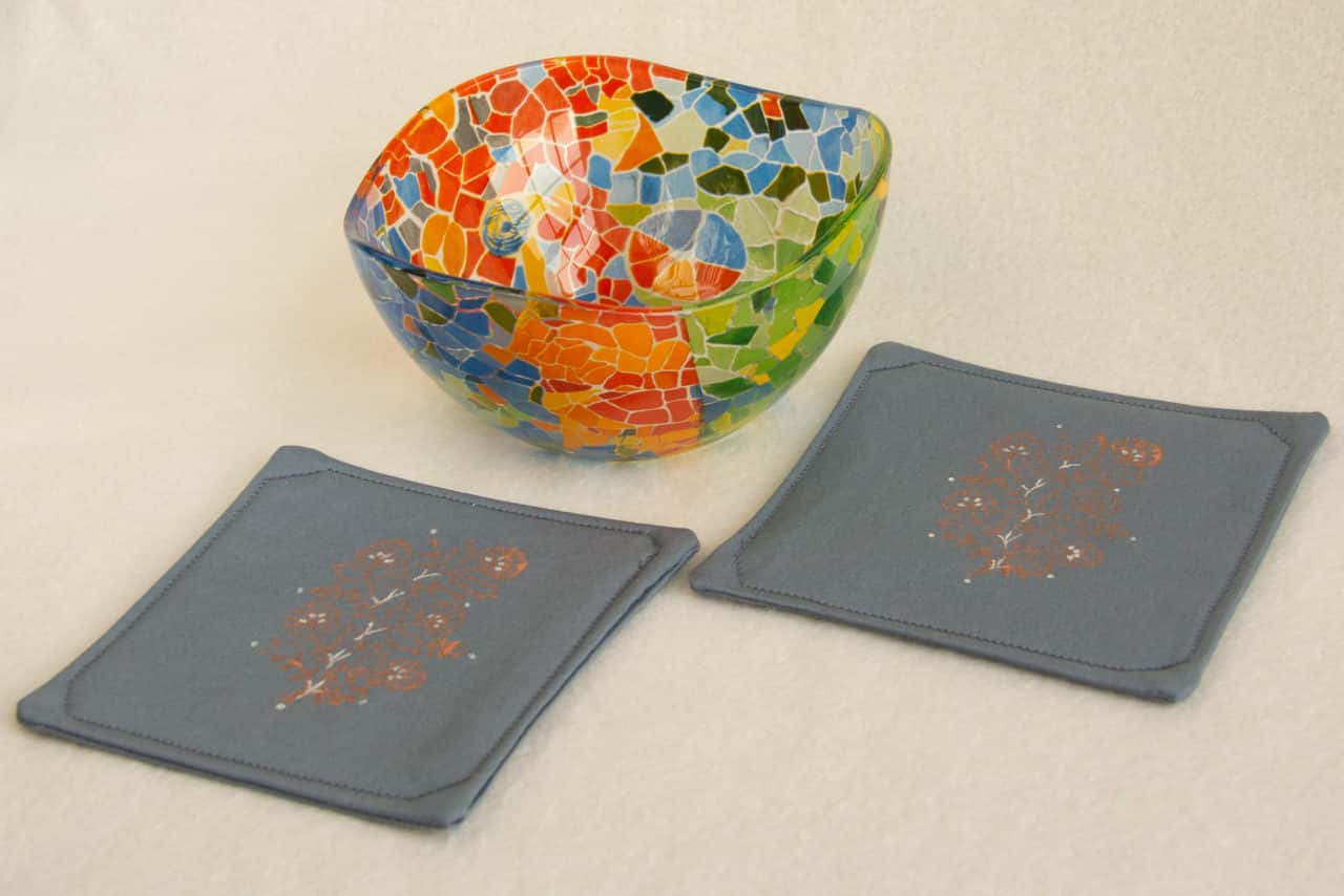 Two coasters with a glass bowl