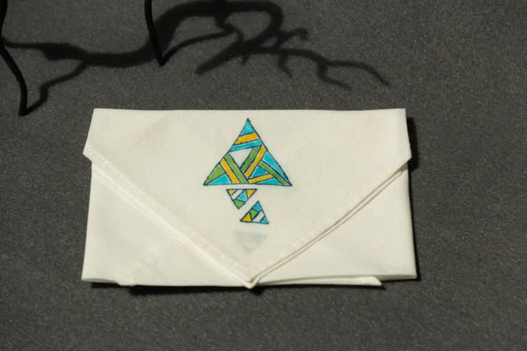 Folded handkerchief with colored triangle prints