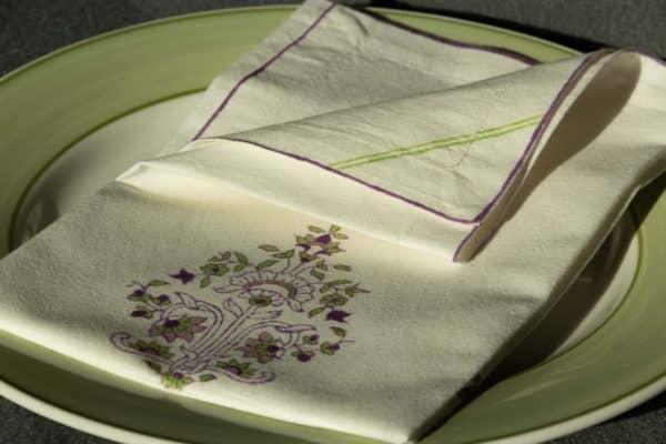 A single folded napkin on a dinner plate